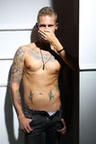Quiet silence ... Handsome tattooed man with no shirt touched by the woman's hand royalty free stock photos