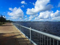 A quiet sky on a desert pier with clouds. A quiet sky on a desert pier in usa with clouds and urban architecture royalty free stock photo