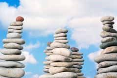 Quiet stones. Stacks of balanced pebbles, stones against colorful blue sky Stock Photography