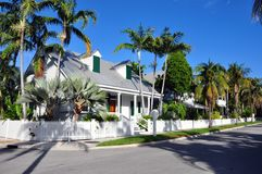 Quiet Street. A quiet palm-lined residential street in Key West, Florida royalty free stock photography
