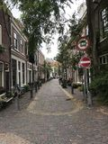 Quiet street in Haarlem. With traditional houses and bicycles in front of Royalty Free Stock Photo