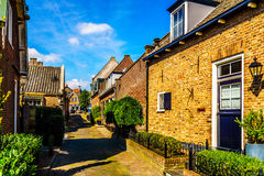 Quiet street in the historic Dutch Fishing Village of Bunschoten-Spakenburg. With Renovated Row Houses on a Sunny Summer day royalty free stock photos