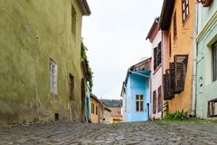 Quiet street, leaving the Fortress Square in the castle of old city. Sighisoara сity in Romania. Quiet street, leaving the Fortress Square in the castle of royalty free stock images