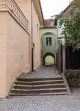 Quiet street, leaving the Fortress Square in the castle of old city. Sighisoara сity in Romania. Quiet street, leaving the Fortress Square in the castle of royalty free stock photos