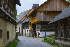 Quiet street with old wooden houses in alpine village Royalty Free Stock Photos