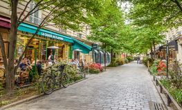 A quiet street with restaurants in the bohemian Marais district of Paris. Paris, France - May 8, 2016. A quiet street with restaurants in the bohemian Marais stock photography