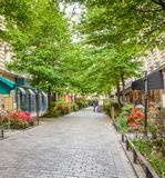 A quiet street with restaurants in the bohemian Marais district of Paris.  royalty free stock photography