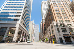Quiet street scene shadow on lower highrise building levels look Stock Photos