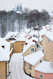 Quiet street with small houses in snow covered Prague Royalty Free Stock Photo