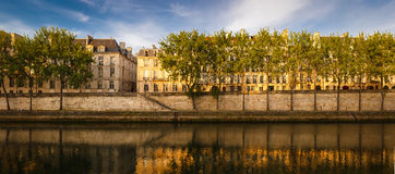 Quiet summer morning by the River Seine, Paris, France. Early morning light on the River Seine banks in Paris. View of Ile Saint Louis with its bank lined with Royalty Free Stock Photography