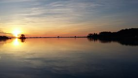 Quiet sunrise over the ocean. Dawn water reflection blue orange Stock Photography