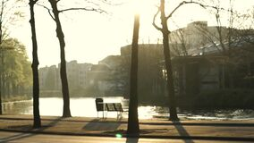 Quiet sunset at Amsterdam Netherland park and seating next to canal