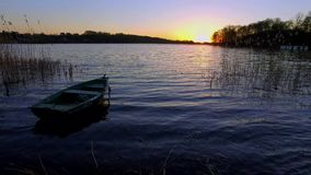 Quiet sunset with the boat and lake stock video footage