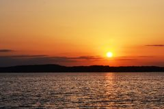 The quiet sunset at the lake. A quiet sunset with calm and relaxing ambiance stock images