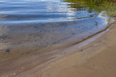 Quiet surf on the sandy shore of Istra Stock Photo