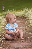 Quiet Time. Young girl sitting in a garden Stock Photo