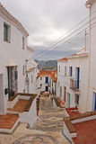 A quiet and tranquil street in the town of Frigiliana, Spain on a cloudy day Royalty Free Stock Images