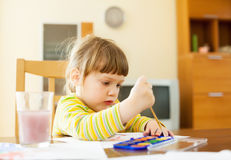 Quiet two year child painting  with watercolor Royalty Free Stock Image