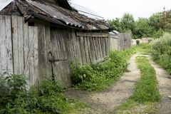 Quiet village street with an old barn Royalty Free Stock Images