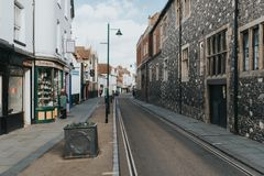 A quiet village street, with shops and traditional architecture in the village of Canterbury, Kent, England stock images