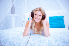 Quiet woman enjoying some music in her bedroom Stock Photos