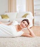 Quiet woman lying on a carpet Stock Photo