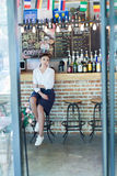 Quietly sit at the bar girl Stock Photography