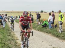 Tim Wellens Riding on a Cobblestone Road - Tour de France 2015. Quievy,France - July 07, 2015: Environmental portrait of the Belgian cyclist Tim Wellens of Lotto Stock Photos