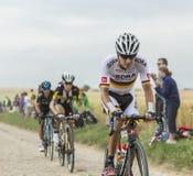 Emanuel Buchmann Riding on a Cobblestone Road - Tour de France 2 Stock Images