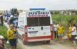 Official Ambulance on a Cobblestone Road - Tour de France 2015. Quievy,France - July 07, 2015: The official ambulance driving on a cobblestoned road before the Royalty Free Stock Images