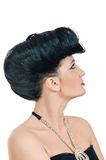 Quiff. Portrait of beautiful girl with elegant coiffure quiff in black dress on white Royalty Free Stock Photos