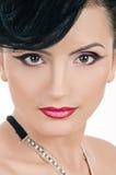 Quiff. Portrait of beautiful girl with elegant coiffure quiff in black dress on white Stock Image