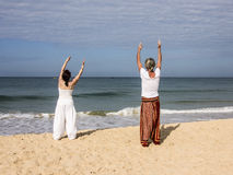 Quigong at the beach of Goa. A couple is performing quigong exercises at the beach of Goa (release available Stock Photos