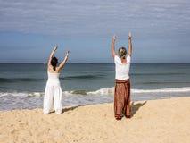 Quigong at the beach of Goa. A couple is performing quigong exercises at the beach of Goa (release available stock photos