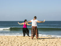 Quigong at the beach of Goa. A couple is performing quigong exercises at the beach of Goa (release available Royalty Free Stock Photos
