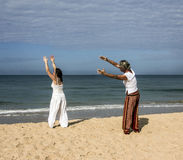Quigong at the beach of Goa. A couple is performing quigong exercises at the beach of Goa (release available Stock Images