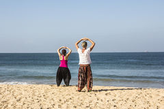 Quigong at the beach of Goa. A couple is performing qigong exercises at the beach of Goa (release available stock photography