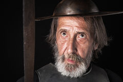 Quijote. Old bearded warrior with breastplate and helmet Stock Image