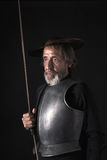 Quijote. Old bearded warrior with breastplate and helmet Stock Photo