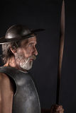 Quijote. Old bearded warrior with breastplate and helmet Stock Images
