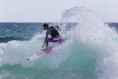 Quiksilver que practica surf Imagen de archivo libre de regalías