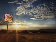 60 quilômetros pela hora e um por do sol Fotografia de Stock Royalty Free