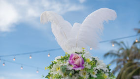 Quill decorate on bouquet with blue sky Royalty Free Stock Photo