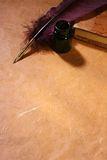 Quill, inkwell & diary. Still-life with a quill , an inkwell and a dairy Stock Image