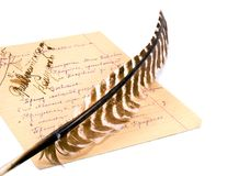 Quill and paper sheet full of notes. The quill and the paper sheet full of notes on white background Stock Images