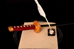Quill Parchment Sword Photographie stock