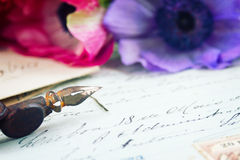 Quill pen and antique letters with flowers Royalty Free Stock Photos