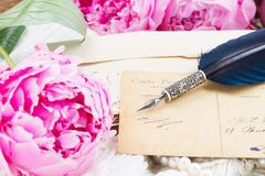Quill pen and antique letters Stock Photos