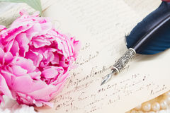 Quill pen and antique letters Stock Image