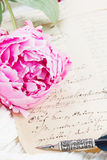 Quill pen and antique letters Stock Images